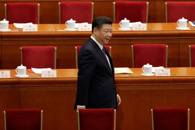 Chinese President Xi Jinping arrives for the third plenary session of the National People's Congress (NPC), where delegates will vote on a constitutional amendment lifting presidential term limits, at the Great Hall of the People in Beijing, China March 11, 2018. REUTERS/Jason Lee