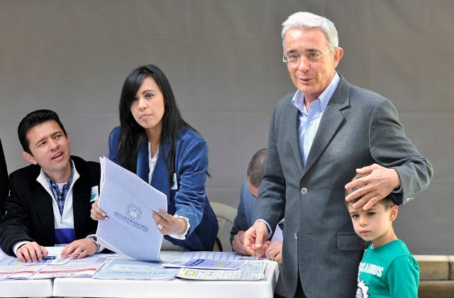 Colombian former President Alvaro Uribe casts his vote during the legislative elections in Bogota, Colombia March 11, 2018. REUTERS/Carlos Julio Martinez   NO RESALES. NO ARCHIVES.