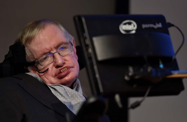 FILE PHOTO: British scientist and theoretical physicist Stephen Hawking attends a launch event for a new award for science communication, called the Stephen Hawking Medal for Science Communication, in London, Britain December 16, 2015. REUTERS/Toby Melville/File Photo