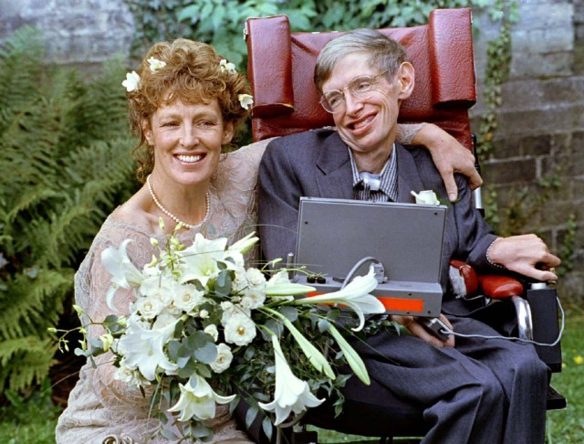 FILE PHOTO: Stephen Hawking and his new bride Elaine Mason pose for pictures after the blessing of their wedding at St. Barnabus Church September 16, 1995. REUTERS/Russell Boyce/File Photo