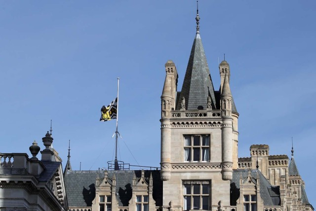 A flag flies at half mast over Gonville and Caius College at the University of Cambridge following the death of Professor Stephen Hawking, in Cambridge, Britain, March 14, 2018. REUTERS/Chris Radburn