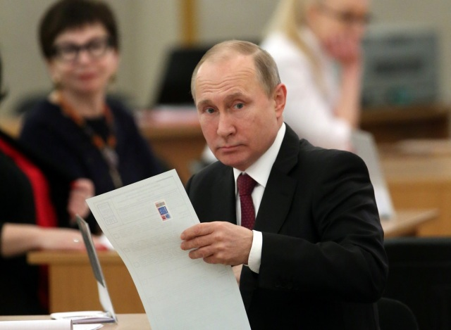 Russian President and Presidential candidate Vladimir Putin at a polling station during the presidential election in Moscow, Russia March 18, 2018. Sergei Chirkov/POOL via Reuters