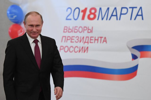 Russian President and Presidential candidate Vladimir Putin at a polling station during the presidential election in Moscow, Russia March 18, 2018. Yuri Kadobnov/POOL via Reuters