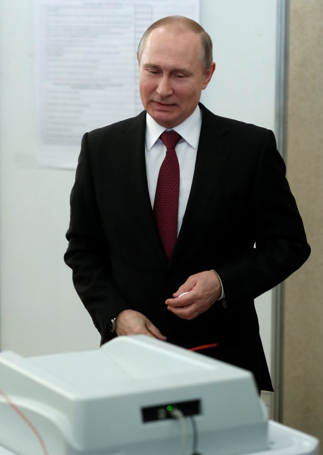 Russian President and Presidential candidate Vladimir Putin smiles after casting his ballot at a polling station during the presidential election in Moscow, Russia March 18, 2018. Sergei Chirkov/POOL via Reuters