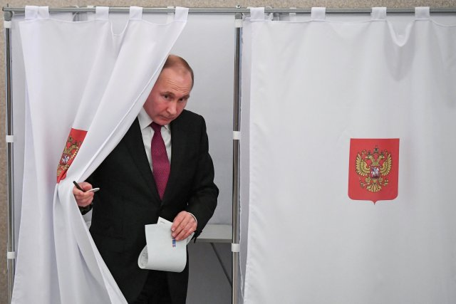 Russian President and Presidential candidate Vladimir Putin at a polling station during the presidential election in Moscow, Russia March 18, 2018. Yuri Kadobnov/POOL via Reuters TPX IMAGES OF THE DAY
