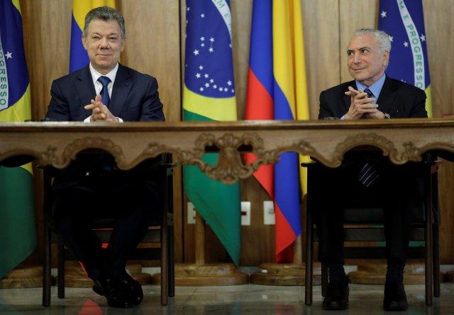 El presidente de Colombia, Juan Manuel Santos, y su homólogo brasileño, Michel Temer. REUTERS/Ueslei Marcelino