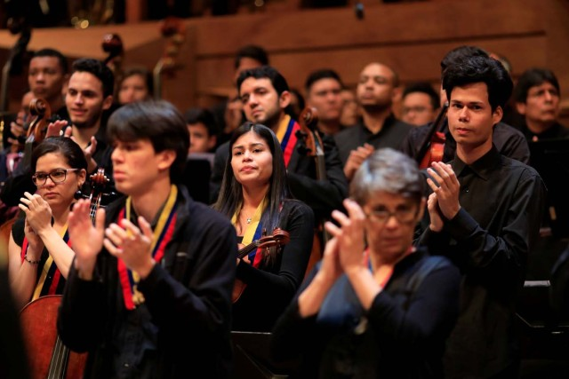 A member of the National System of Children and Youth Orchestras reacts during the memorial service of its founder Jose Antonio Abreu in Caracas, Venezuela March 25, 2018. REUTERS/Marco Bello