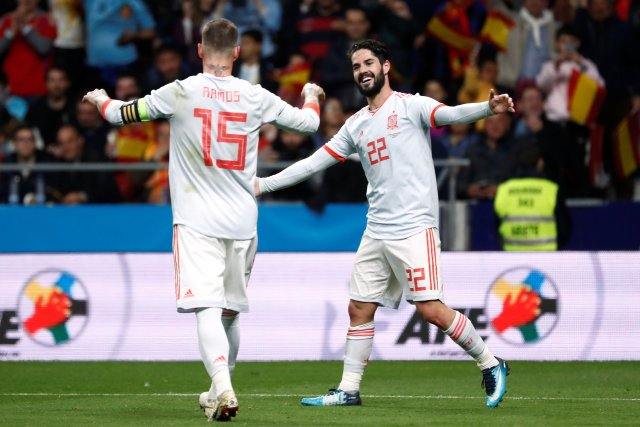 Soccer Football - International Friendly - Spain vs Argentina - Wanda Metropolitano, Madrid, Spain - March 27, 2018   Spain's Isco celebrates scoring their sixth goal and completing his hat-trick with Sergio Ramos    REUTERS/Juan Medina