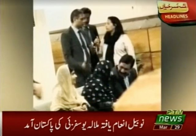 Nobel laureate and education activist Malala Yousafzai sits with her family in a VIP lounge of Islamabad Airport upon her arrival in Islamabad, Pakistan, in this still image taken from PTV video footage released on March 29, 2018. PTV/via REUTERS ATTENTION EDITORS - THIS IMAGE HAS BEEN SUPPLIED BY A THIRD PARTY. NO RESALES. NO ARCHIVES. PAKISTAN OUT. NO COMMERCIAL OR EDITORIAL SALES IN PAKISTAN