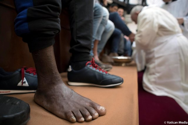 Pope Francis washes the foot of a inmate at the Regina Coeli prison during the Holy Thursday celebration in Rome, Italy, March 29, 2018. Osservatore Romano/Handout via REUTERS ATTENTION EDITORS - THIS IMAGE WAS PROVIDED BY A THIRD PARTY