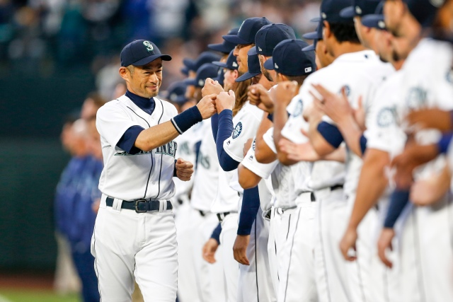 Mar 29, 2018; Seattle, WA, USA; Seattle Mariners left fielder Ichiro Suzuki (51) (left) greets teammates during player introductions before a game against the Cleveland Indians at Safeco Field. Mandatory Credit: Joe Nicholson-USA TODAY Sports