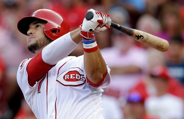 Cincinnati Reds' Eugenio Suarez hits a sacrifice fly off Pittsburgh Pirates starting pitcher Gerrit Cole to drive home Marlon Byrd in the second inning of a baseball game, Saturday, Aug. 1, 2015, in Cincinnati. (AP Photo/John Minchillo)