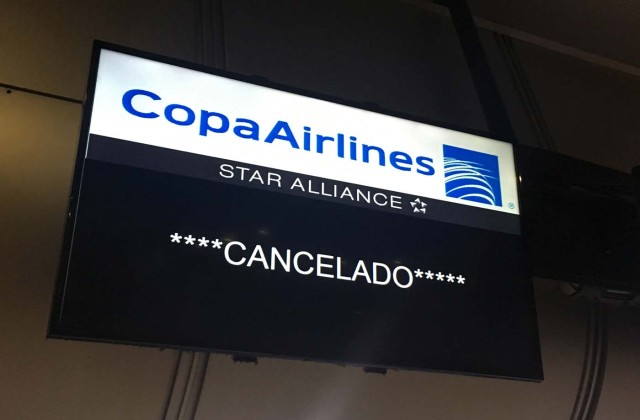 A screen of Panama's Copa Airlines announces a flight has been cancelled at Caracas' international airport on April 6, 2018 after Venezuela suspended flights of the company in an escalating diplomatic row. Panama on April 5 ordered Venezuela's ambassador out and recalled its own envoy to the country as Caracas imposed sanctions on senior Panamanian officials and suspended flights in an escalating diplomatic row. At issue is Panama's alignment with other Latin American countries as well as the European Union, Canada and the United States that have taken measures against President Nicolas Maduro's and his government on the grounds that he is undemocratically tightening his hold on power. / AFP PHOTO / Federico PARRA