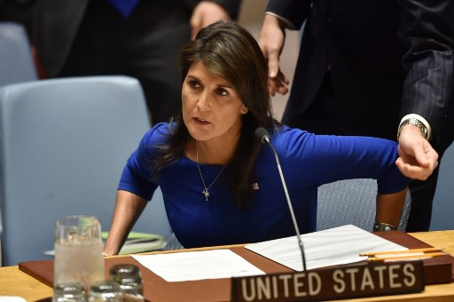 """US Ambassador to the United Nations, Nikki Haley, arrives for a UN Security Council meeting, at United Nations Headquarters in New York, on April 14, 2018. The UN Security Council on Saturday opened a meeting at Russia's request to discuss military strikes carried out by the United States, France and Britain on Syria in response to a suspected chemical weapons attack. Russia circulated a draft resolution calling for condemnation of the military action, but Britain's ambassador said the strikes were """"both right and legal"""" to alleviate humanitarian suffering in Syria. / AFP PHOTO / HECTOR RETAMAL"""