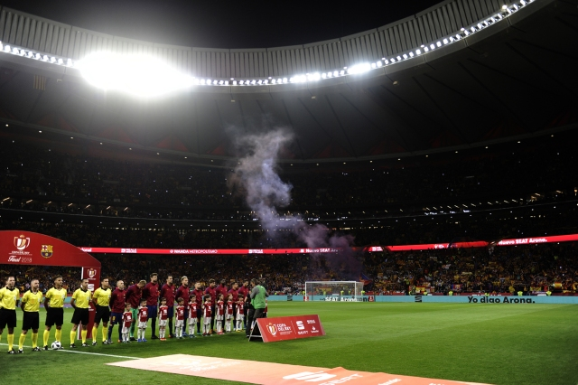 Barcelona's players listen to the Spanish anthem before the Spanish Copa del Rey (King's Cup) final football match Sevilla FC against FC Barcelona at the Wanda Metropolitano stadium in Madrid on April 21, 2018.  / AFP PHOTO / CRISTINA QUICLER