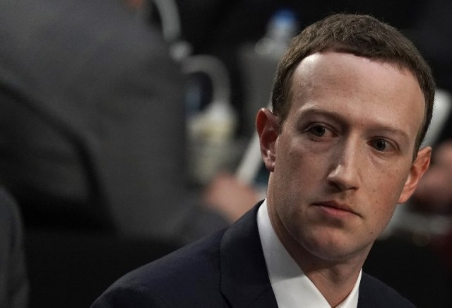 WASHINGTON, DC - APRIL 10: Facebook co-founder, Chairman and CEO Mark Zuckerberg testifies before a combined Senate Judiciary and Commerce committee hearing in the Hart Senate Office Building on Capitol Hill April 10, 2018 in Washington, DC. Zuckerberg, 33, was called to testify after it was reported that 87 million Facebook users had their personal information harvested by Cambridge Analytica, a British political consulting firm linked to the Trump campaign.   Alex Wong/Getty Images/AFP