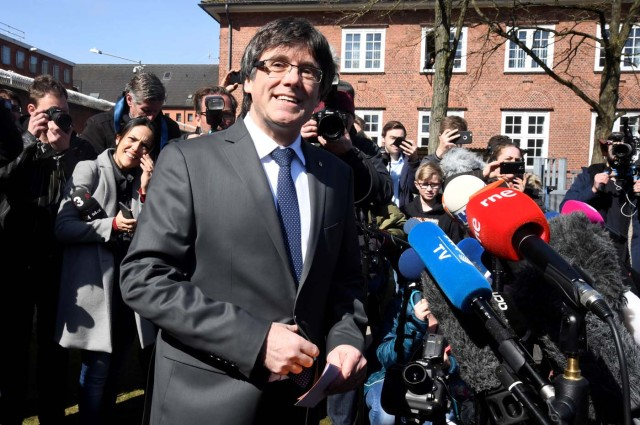 Catalonia's former leader Carles Puigdemont talks to the media as he leaves the prison in Neumuenster, Germany, April 6, 2018. A German court on Thursday rejected an extradition request for Puigdemont on the charge of rebellion for his role in the campaign for the region's independence. REUTERS/Fabian Bimmer