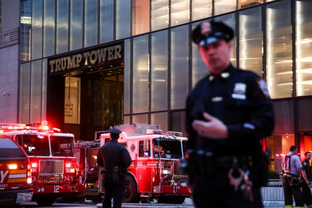 First responders work on a fire in a residential unit at Trump tower in the Manhattan borough of New York City, New York, U.S., April 7, 2018. REUTERS/Amr Alfiky