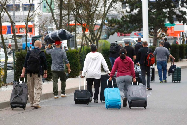 Passengers walk at the airport as public traffic is closed due to German public sector workers union Verdi strike in demand for higher wages in Frankfurt,Germany April 10,2018. REUTERS/Kai Pfaffenbach