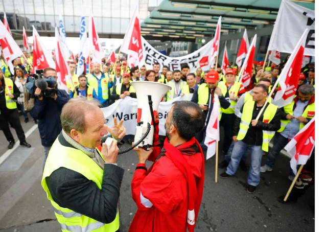 German public sector workers union Verdi leader Frank Bsirske (L) speaks during the strike at the airport in demand for higher wages in Frankfurt, Germany April 10, 2018. REUTERS/Kai Pfaffenbach