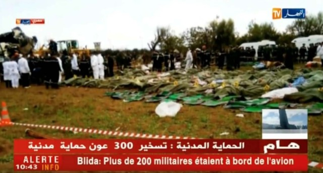 Bodies are seen on the ground after a plane crashed into a field outside Algiers, Algeria April 11, 2018 in this still image taken from a video. ENNAHAR TV/Handout/ via REUTERS  THIS IMAGE HAS BEEN SUPPLIED BY A THIRD PARTY. ALGERIA OUT. NO COMMERCIAL OR EDITORIAL SALES IN ALGERIA. NO RESALES. NO ARCHIVES.