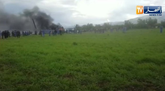 Smoke rises at the scene where a plane crashed into a field outside Algiers, Algeria April 11, 2018 in this still image taken from a video. ENNAHAR TV/Handout/ via REUTERS  THIS IMAGE HAS BEEN SUPPLIED BY A THIRD PARTY. ALGERIA OUT. NO COMMERCIAL OR EDITORIAL SALES IN ALGERIA. NO RESALES. NO ARCHIVES.