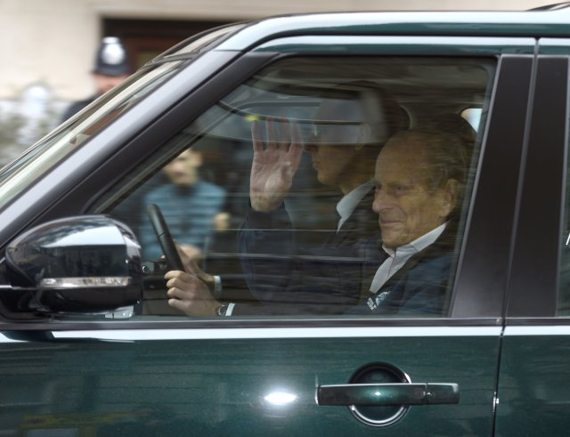 Britain's Prince Philip waves as he is driven away from King Edward VII's Hospital where he recently underwent hip replacement surgery, in central London, April 13, 2018. REUTERS/Peter Summers