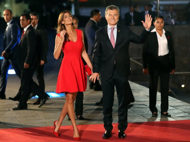 Argentine President Mauricio Macri and First Lady Juliana Awada arrive for the inauguration of the VIII Summit of the Americas in Lima, Peru April 13, 2018. REUTERS/Marcos Brindicci