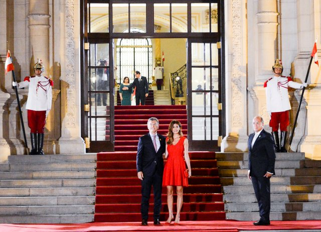 Argentina's President Mauricio Macri and First Lady Juliana Awada pose for a photo at the inauguration of the VIII Summit of the Americas in Lima, Peru April 13, 2018. Argentine Presidency/Handout via REUTERS ATTENTION EDITORS - THIS IMAGE WAS PROVIDED BY A THIRD PARTY.
