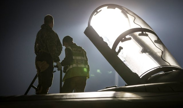 Image of a Tornado Navigator getting into the cockpit, in Akrotiri, Cyprus April 13, 2018. Picture taken April 13, 2018. © UK MOD Crown 2018/Handout via REUTERS. ATTENTION EDITORS - THIS IMAGE HAS BEEN SUPPLIED BY A THIRD PARTY. MANDATORY CREDIT. NO RESALES. NO ARCHIVES