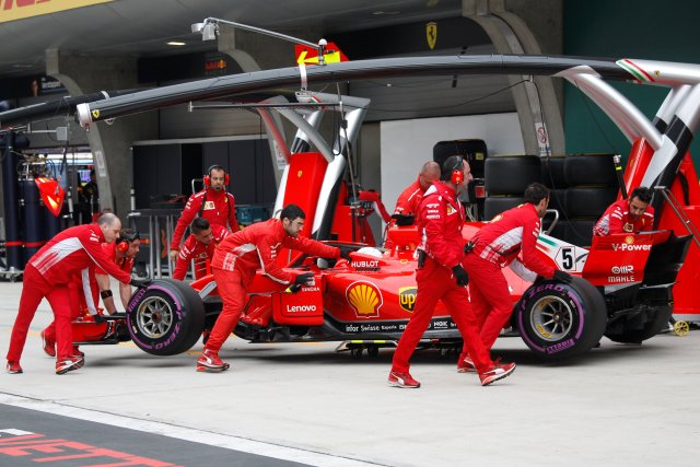 Formula One - F1 - Chinese Grand Prix - Shanghai, China - April 14, 2018 - The car of Ferrari driver Sebastian Vettel is pushed back to the team's garage during the qualifying session. Pool via REUTERS
