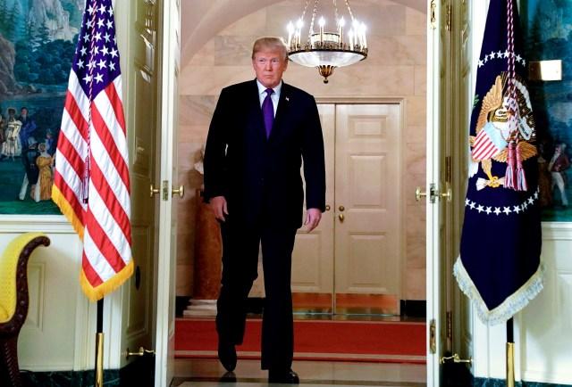 El presidente de Estados Unidos, Donald Trump, antes de anunciar el ataque militar a Siria, en la Casa Blanca en Washington. 13 de abril de 2018. REUTERS/Yuri Gripas