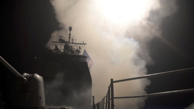 Smoke rises as the U.S. Navy guided-missile cruiser USS Monterey fires Tomahawk land attack missiles in this still image from Pentagon's video released on April 14, 2018. U.S. Navy Lt. j.g Matthew Daniels/Handout via REUTERS. ATTENTION EDITORS - THIS IMAGE WAS PROVIDED BY A THIRD PARTY