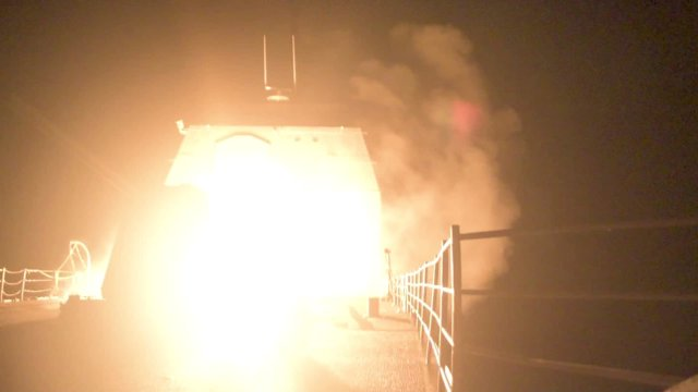 The U.S. Navy guided-missile cruiser USS Monterey is lit as it fires Tomahawk land attack missiles in this still image from Pentagon's video released on April 14, 2018.   U.S. Navy Lt. j.g Matthew Daniels/Handout via REUTERS. ATTENTION EDITORS - THIS IMAGE WAS PROVIDED BY A THIRD PARTY