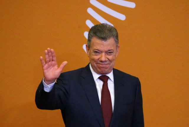 Colombia's President Juan Manuel Santos arrives for the family photo during the VIII Summit of the Americas in Lima, Peru April 14, 2018. REUTERS/ Ivan Alvarado