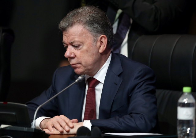 Colombia's President Juan Manuel Santos participates in the opening session of the Americas Summit in Lima, Peru April 14, 2018. REUTERS/Andres Stapff