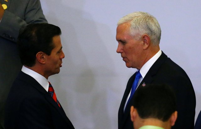 Mexico's President Enrique Pena Nieto and U.S. Vice President Mike Pence shake hands at the family photo of the VIII Summit of the Americas in Lima, Peru April 14, 2018. REUTERS/ Ivan Alvarado