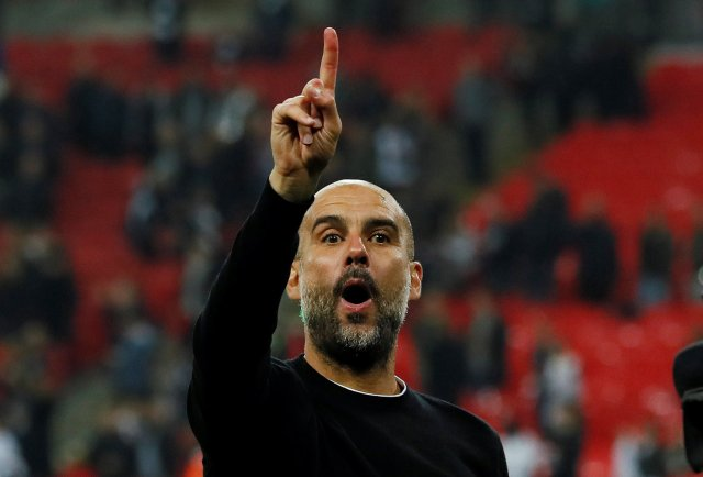 """Soccer Football - Premier League - Tottenham Hotspur vs Manchester City - Wembley Stadium, London, Britain - April 14, 2018   Manchester City manager Pep Guardiola celebrates after the match    REUTERS/David Klein    EDITORIAL USE ONLY. No use with unauthorized audio, video, data, fixture lists, club/league logos or """"live"""" services. Online in-match use limited to 75 images, no video emulation. No use in betting, games or single club/league/player publications.  Please contact your account representative for further details."""