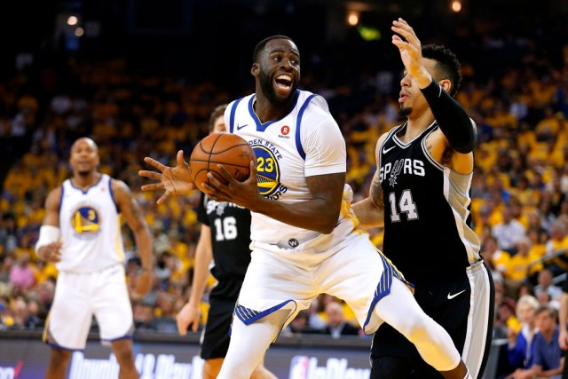 Apr 14, 2018; Oakland, CA, USA; Golden State Warriors forward Draymond Green (23) spins towards the hoop next to San Antonio Spurs guard Danny Green (14) in the second quarter in game one of the first round of the 2018 NBA Playoffs at Oracle Arena. Mandatory Credit: Cary Edmondson-USA TODAY Sports