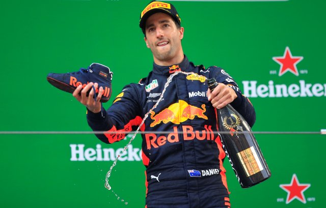 Formula One F1 - Chinese Grand Prix - Shanghai International Circuit, Shanghai, China - April 15, 2018 Red Bull's Daniel Ricciardo with champagne and a shoe as he celebrates winning the race REUTERS/Aly Song