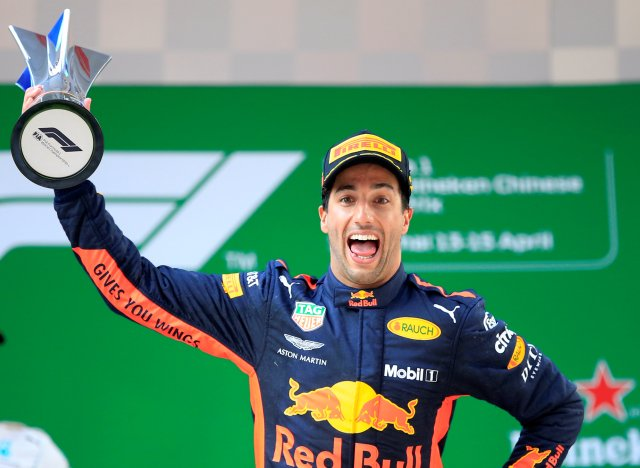 Formula One F1 - Chinese Grand Prix - Shanghai International Circuit, Shanghai, China - April 15, 2018 Red Bull's Daniel Ricciardo celebrates with a trophy on the podium after winning the race REUTERS/Aly Song