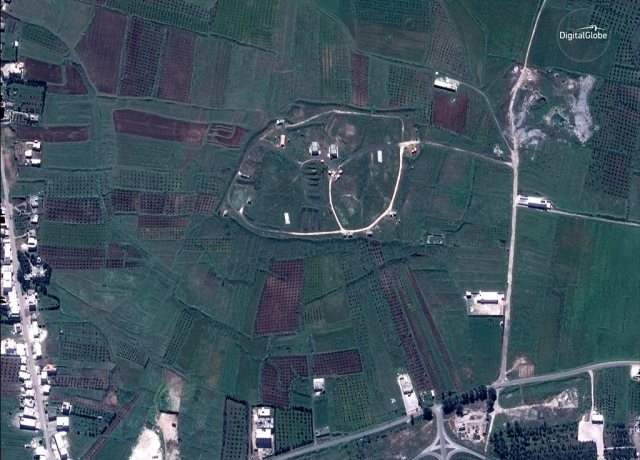 A satellite image shows the Him Shinshar Storage site west of the city of Homs, Syria, April 13, 2018. Picture taken April 13, 2018.   Satellite Image ©DigitalGlobe/Handout via REUTERS    ATTENTION EDITORS - THIS IMAGE WAS PROVIDED BY A THIRD PARTY.  MANDATORY CREDIT.  NO RESALES.  NO ARCHIVES.