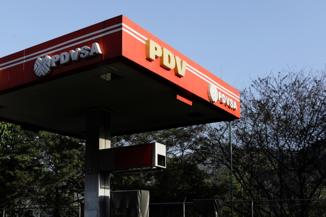 The corporate logo of the state oil company PDVSA is seen at a gas station in Caracas, Venezuela March 18, 2018. Picture taken March 18, 2018. REUTERS/Marco Bello