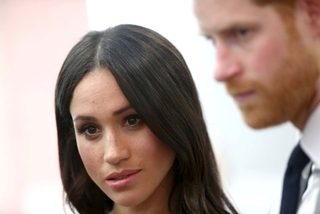 Britain's Prince Harry and his fiancee Meghan Markle attend a reception with delegates from the Commonwealth Youth Forum at the Queen Elizabeth II Conference Centre, London, April 18, 2018. Yui Mok/Pool via Reuters