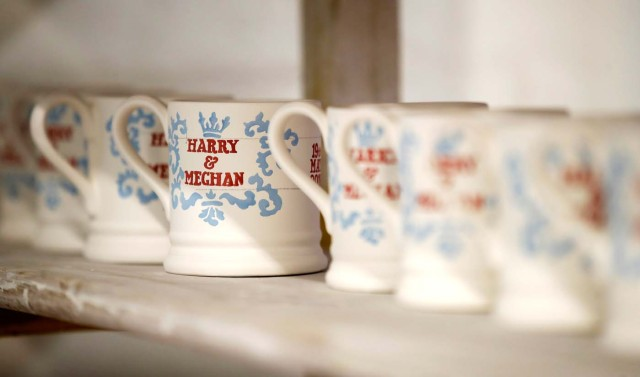 Mugs commemorating the wedding of Britain's Prince Harry and Meghan Markle wait to be glazed at the Emma Bridgewater Factory, in Hanley, Stoke-on-Trent, Britain March 28, 2018. Picture taken March 28, 2018. REUTERS/Carl Recine