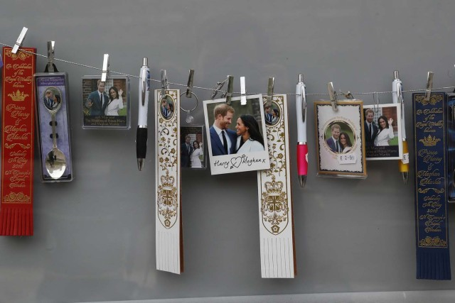 Souvenirs featuring Britain's Prince Harry and his fiancee Meghan Markle hang on display in a shop near Windsor Castle in Windsor, Britain, April 1, 2018. Picture taken April 1, 2018. REUTERS/Simon Dawson