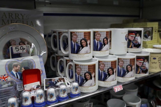 Souvenirs featuring Britain's Prince Harry and his fiancee Meghan Markle sit on display in a shop near Windsor Castle in Windsor, Britain, April 1, 2018. Picture taken April 1, 2018. REUTERS/Simon Dawson