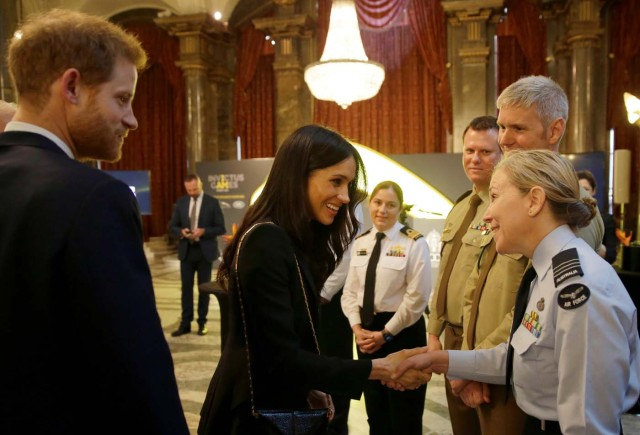 Britain's Prince Harry and Meghan Markle greet members of the Australian Defence Force during a reception celebrating the forthcoming Invictus Games Sydney 2018, hosted by Malcolm Turnbull, Prime Minister of Australia, and his wife Lucy Turnbull, at Australia House in London, Britain April 21, 2018. Alastair Grant/Pool via Reuters