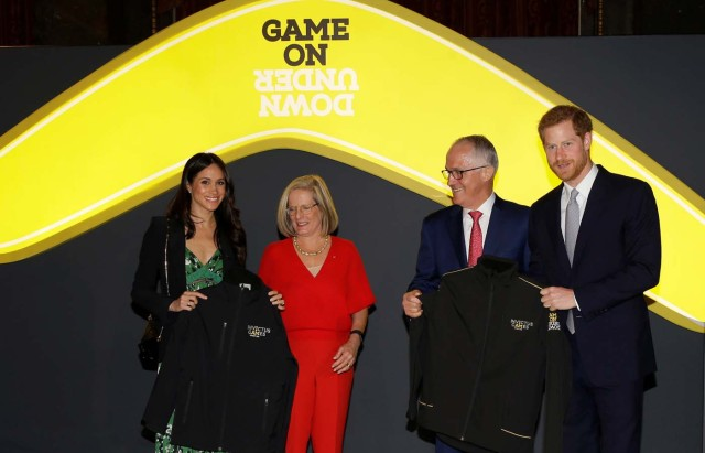 Britain's Prince Harry and Meghan Markle receive Invictus Games jackets during a reception celebrating the forthcoming Invictus Games Sydney 2018, hosted by Malcolm Turnbull, Prime Minister of Australia, and his wife Lucy Turnbull, at Australia House in London, Britain April 21, 2018. Alastair Grant/Pool via Reuters