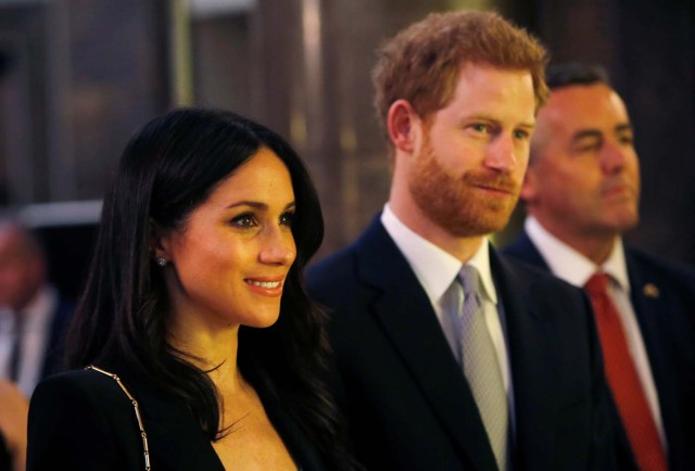 Britain's Prince Harry and Meghan Markle attend a reception celebrating the forthcoming Invictus Games Sydney 2018, hosted by Malcolm Turnbull, Prime Minister of Australia, and his wife Lucy Turnbull, at Australia House in London, Britain April 21, 2018. Alastair Grant/Pool via Reuters
